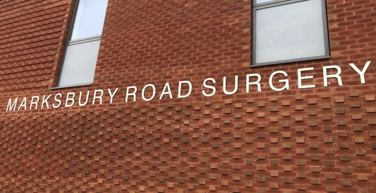 A brick building. Sign reads 'Marksbury Road Surgery'