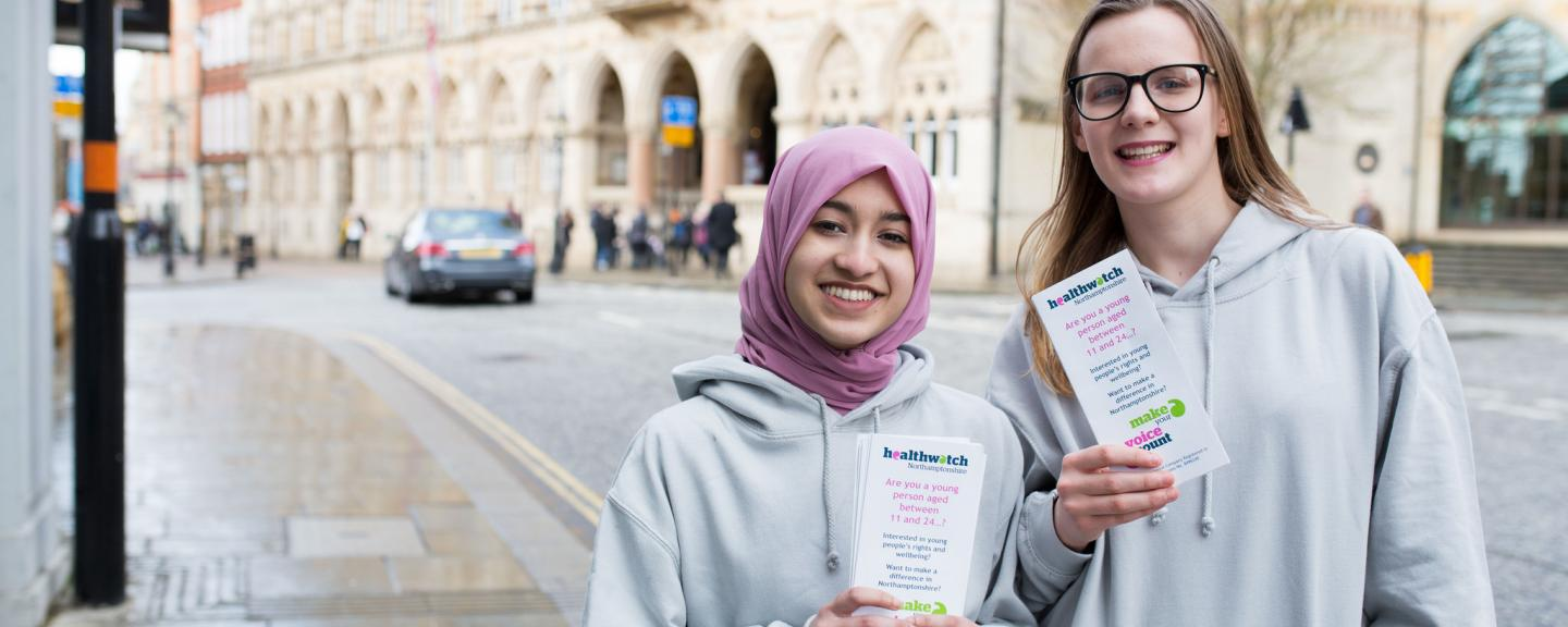Two young female volunteers promoting Healthwatch