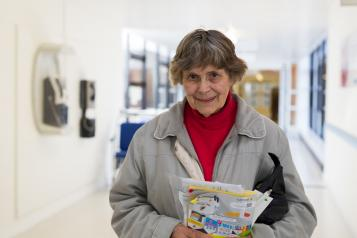 Older woman holding a packet of tablets